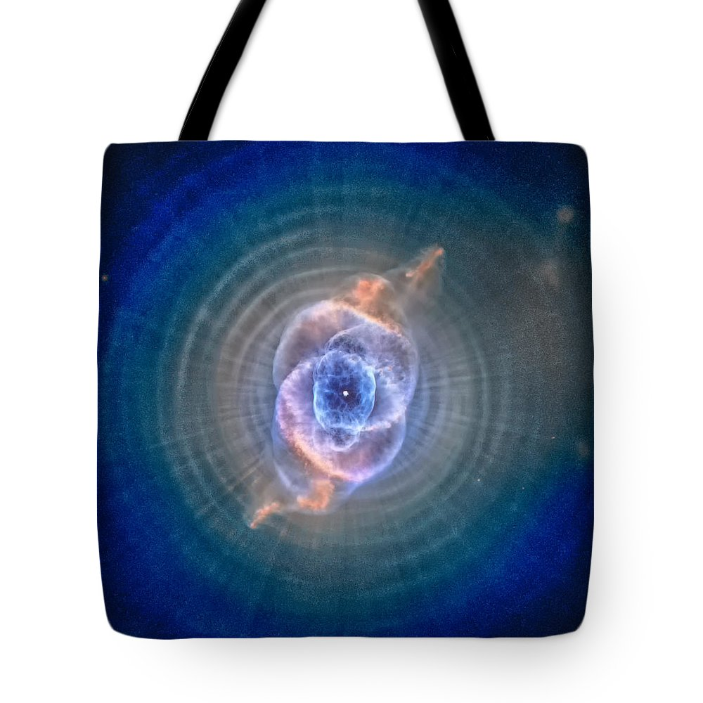 Cats Eye Tote Bag featuring the photograph Cat's Eye Nebula by Eti Reid