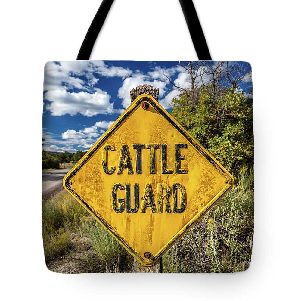 Photography Tote Bag featuring the photograph Cattle Guard Road Sign by Panoramic Images
