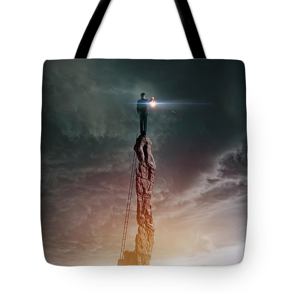 Corporate Business Tote Bag featuring the photograph Caucasian Man With Lantern On Rocky by Colin Anderson Productions Pty Ltd