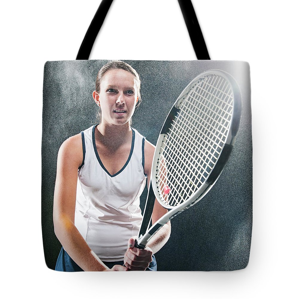 Cool Attitude Tote Bag featuring the photograph Caucasian Tennis Player In Rain by Erik Isakson