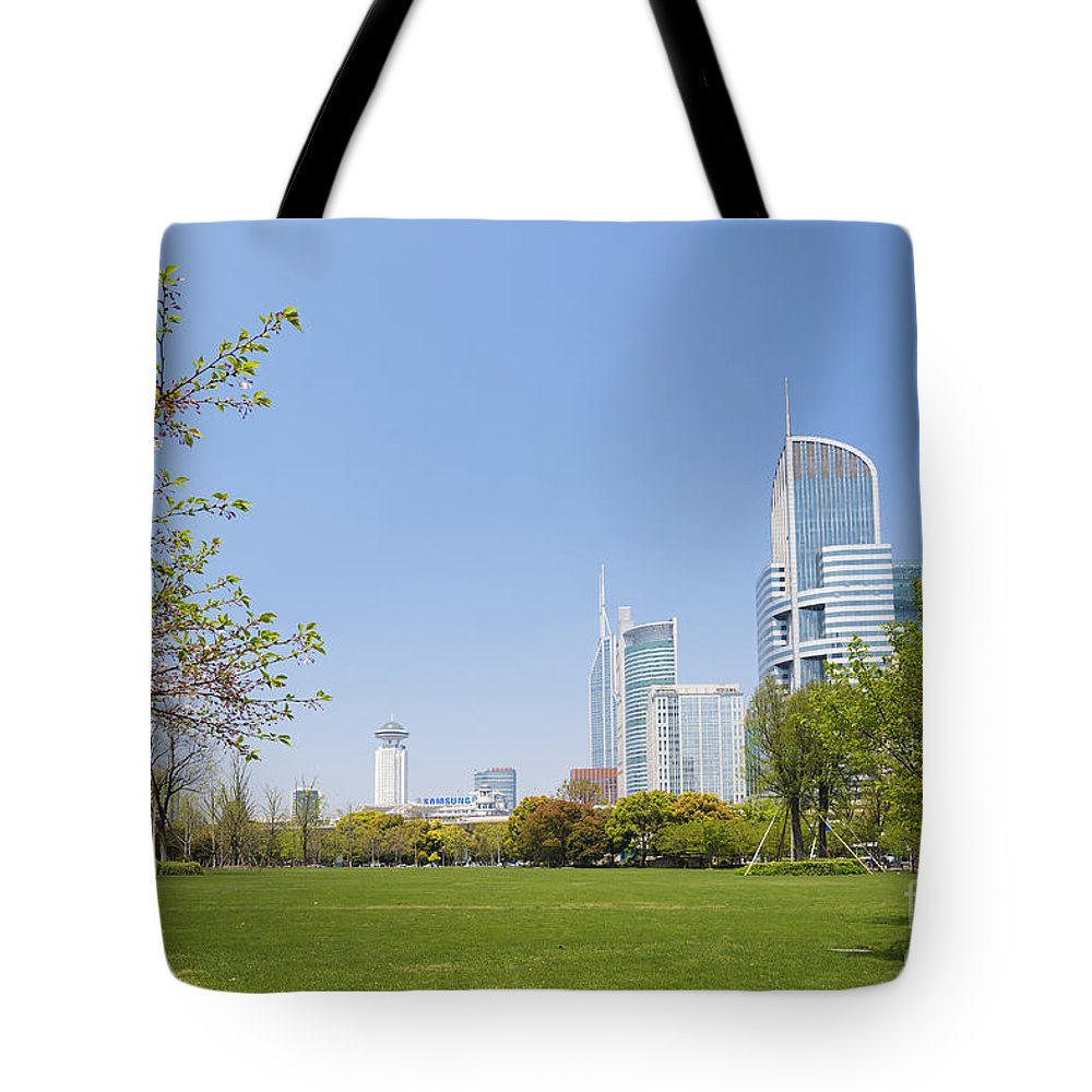 Architecture Tote Bag featuring the photograph Central Shanghai In China by Jacek Malipan