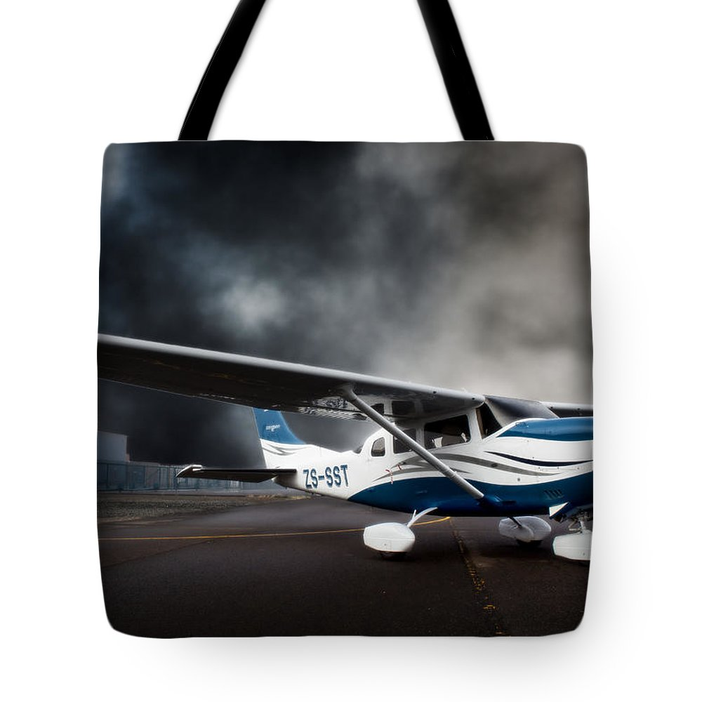 Cessna Tote Bag featuring the photograph Cessna Ground by Paul Job