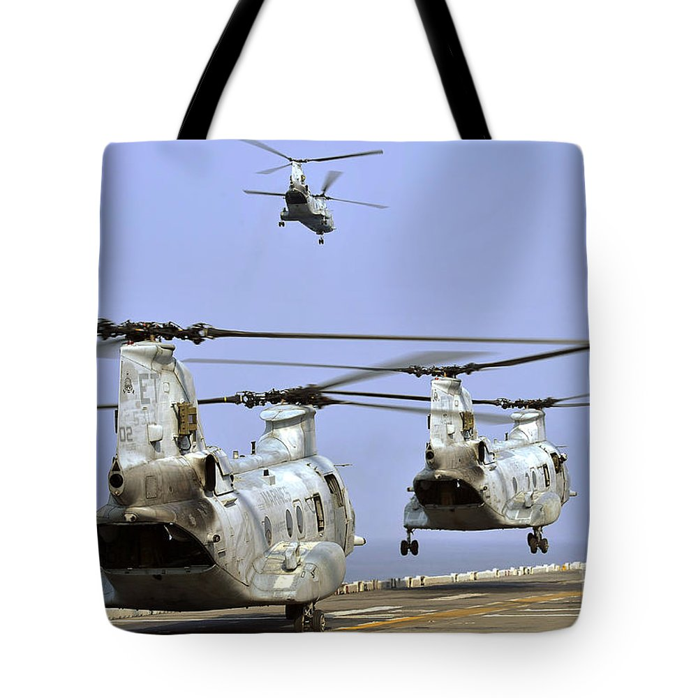 Military Tote Bag featuring the photograph Ch-46e Sea Knight Helicopters Take by Stocktrek Images