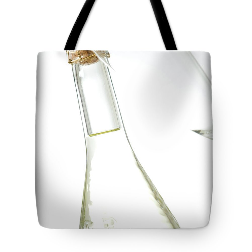White Background Tote Bag featuring the photograph Champagne Bottle by Davidwiberg