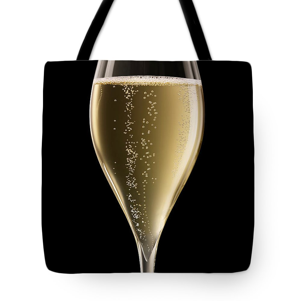 Alcohol Tote Bag featuring the photograph Champagne Glass Xxxl by Jamesachard