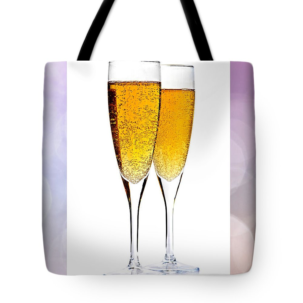 Champagne Tote Bag featuring the photograph Champagne In Glasses by Elena Elisseeva