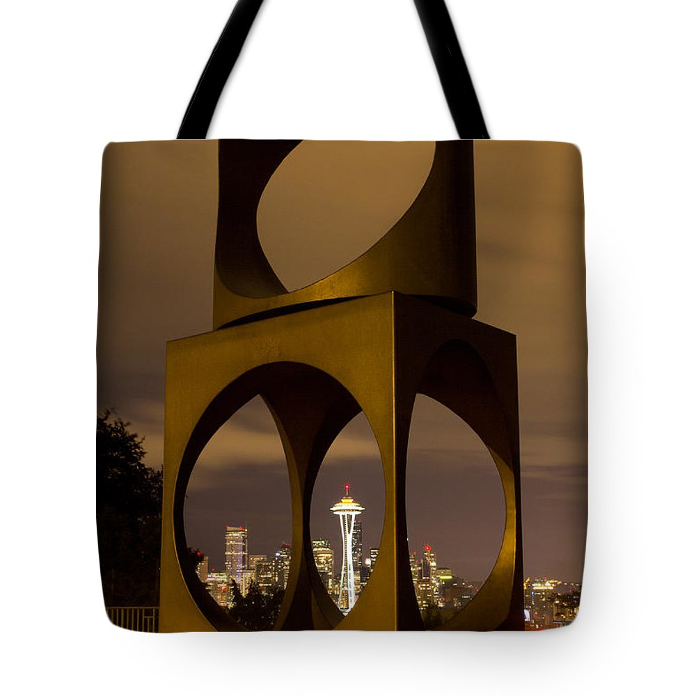 Kerry Tote Bag featuring the photograph Changing Form Of Seattle by Charlie Duncan