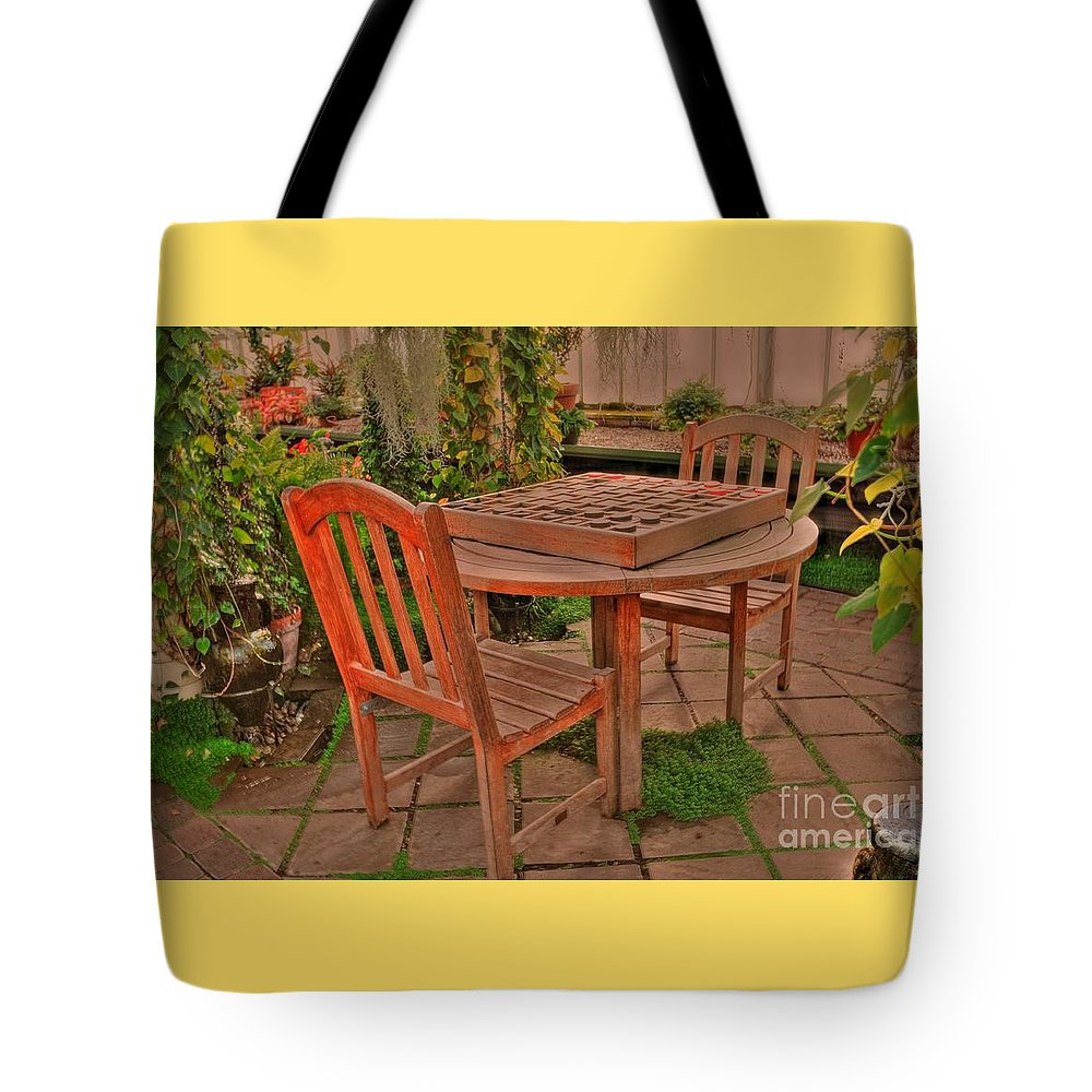 #wooden #checker #board #round #table# Chair Tote Bag featuring the photograph Checkers by Kathleen Struckle