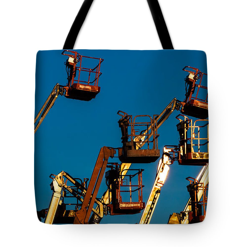 Boom Lifts Tote Bag featuring the photograph Cherry Cherry Pickers by Ed Gleichman
