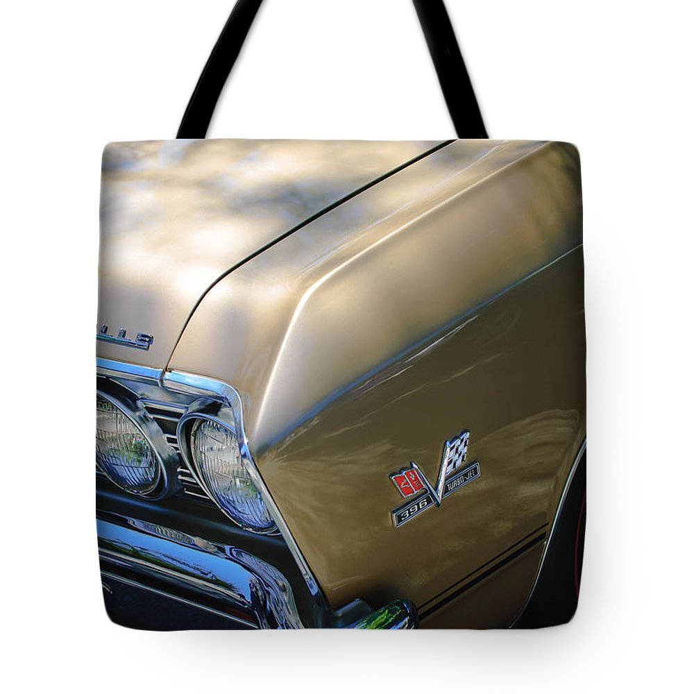 Chevrolet Chevelle Ss Headlight Emblems Tote Bag featuring the photograph Chevrolet Chevelle Ss Headlight Emblems by Jill Reger