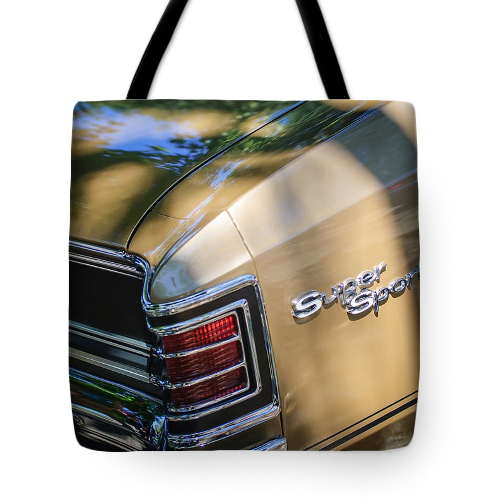 Chevrolet Chevelle Ss Taillight Emblems Tote Bag featuring the photograph Chevrolet Chevelle Ss Taillight Emblems by Jill Reger