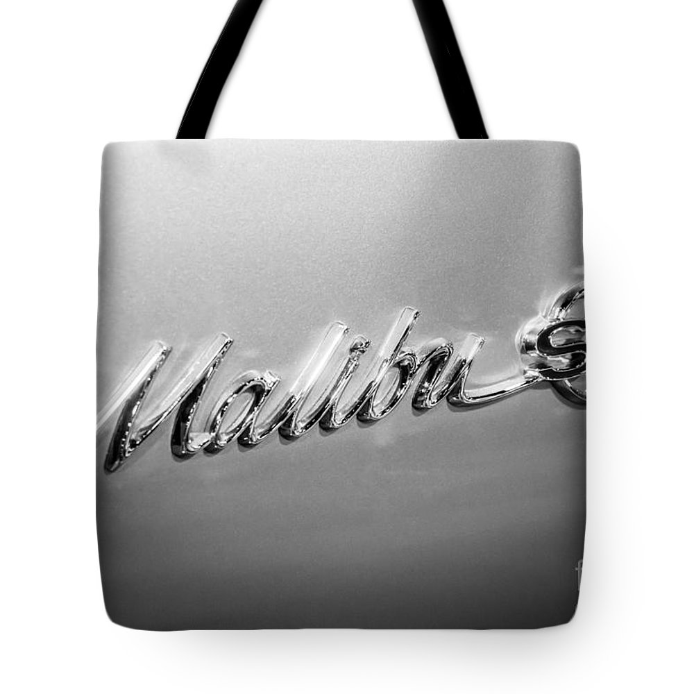 1960's Tote Bag featuring the photograph Chevrolet Malibu Ss Emblem Black And White Picture by Paul Velgos