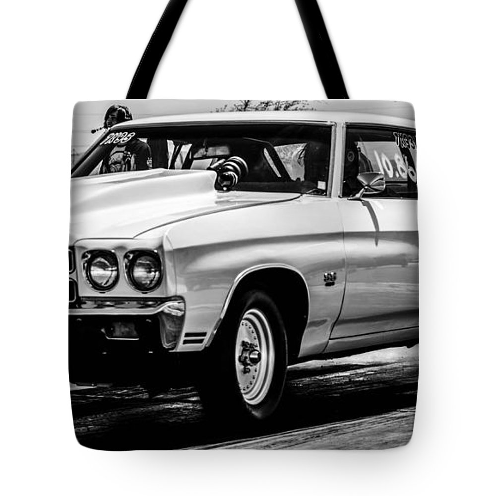 Black Tote Bag featuring the photograph Chevy Chevrolet Chevelle Ss Burning Rubber by Michael Moriarty