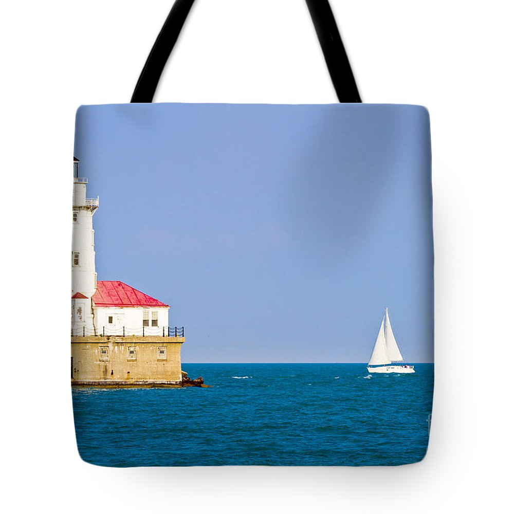 Chicago Tote Bag featuring the photograph Chicago Harbor Lighthouse by Ohad Shahar