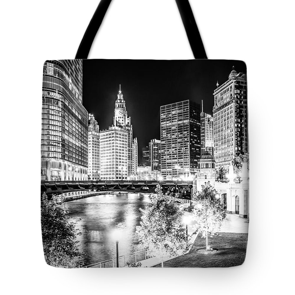 America Tote Bag featuring the photograph Chicago River Buildings at Night in Black and White by Paul Velgos