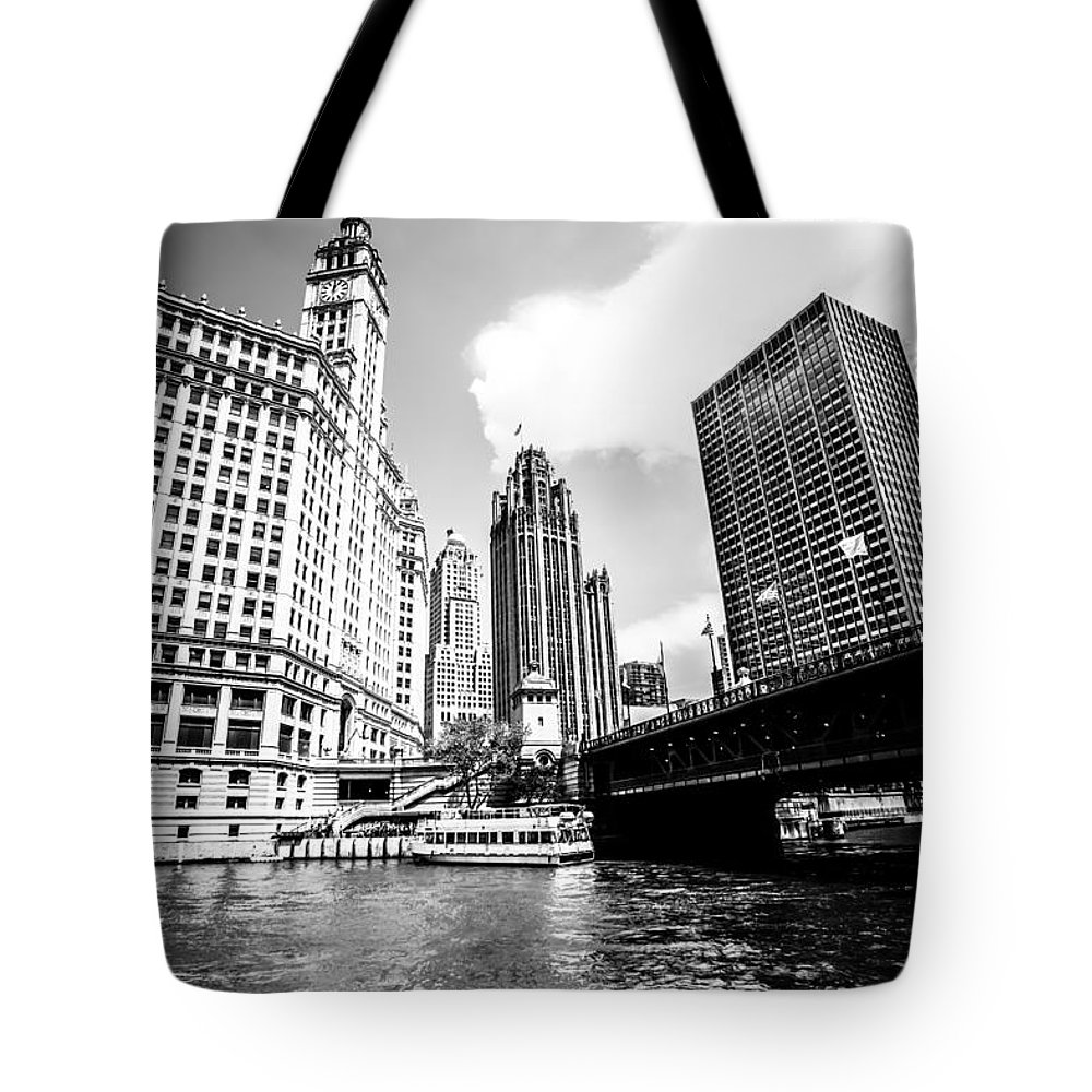 America Tote Bag featuring the photograph Chicago Wrigley Tribune Equitable Buildings Black And White Phot by Paul Velgos