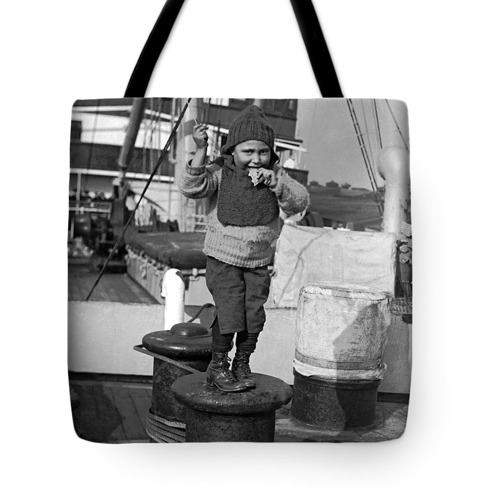 1926 Tote Bag featuring the photograph Child Arriving At Ellis Island by Underwood Archives