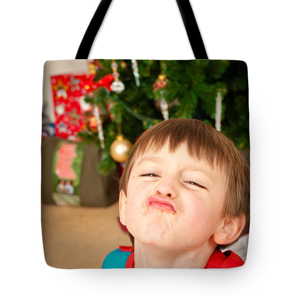 Beautiful Tote Bag featuring the photograph Child At Christmas by Tom Gowanlock