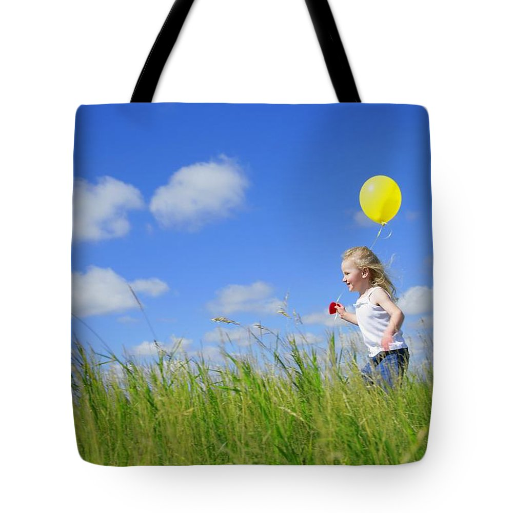 Freedom Tote Bag featuring the photograph Child Running With A Balloon by Don Hammond