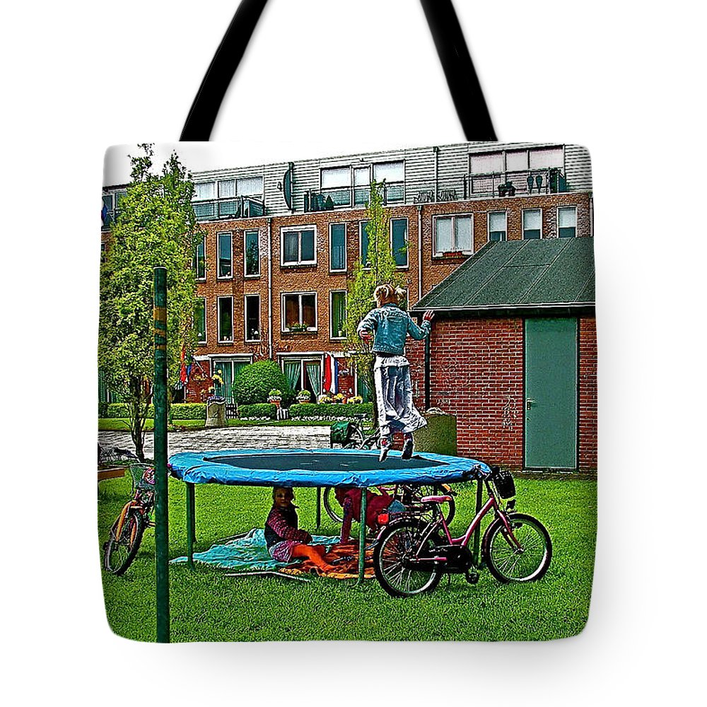 Children At Play In Enkhuizen Tote Bag featuring the photograph Children At Play In Enkhuizen-netherlands by Ruth Hager