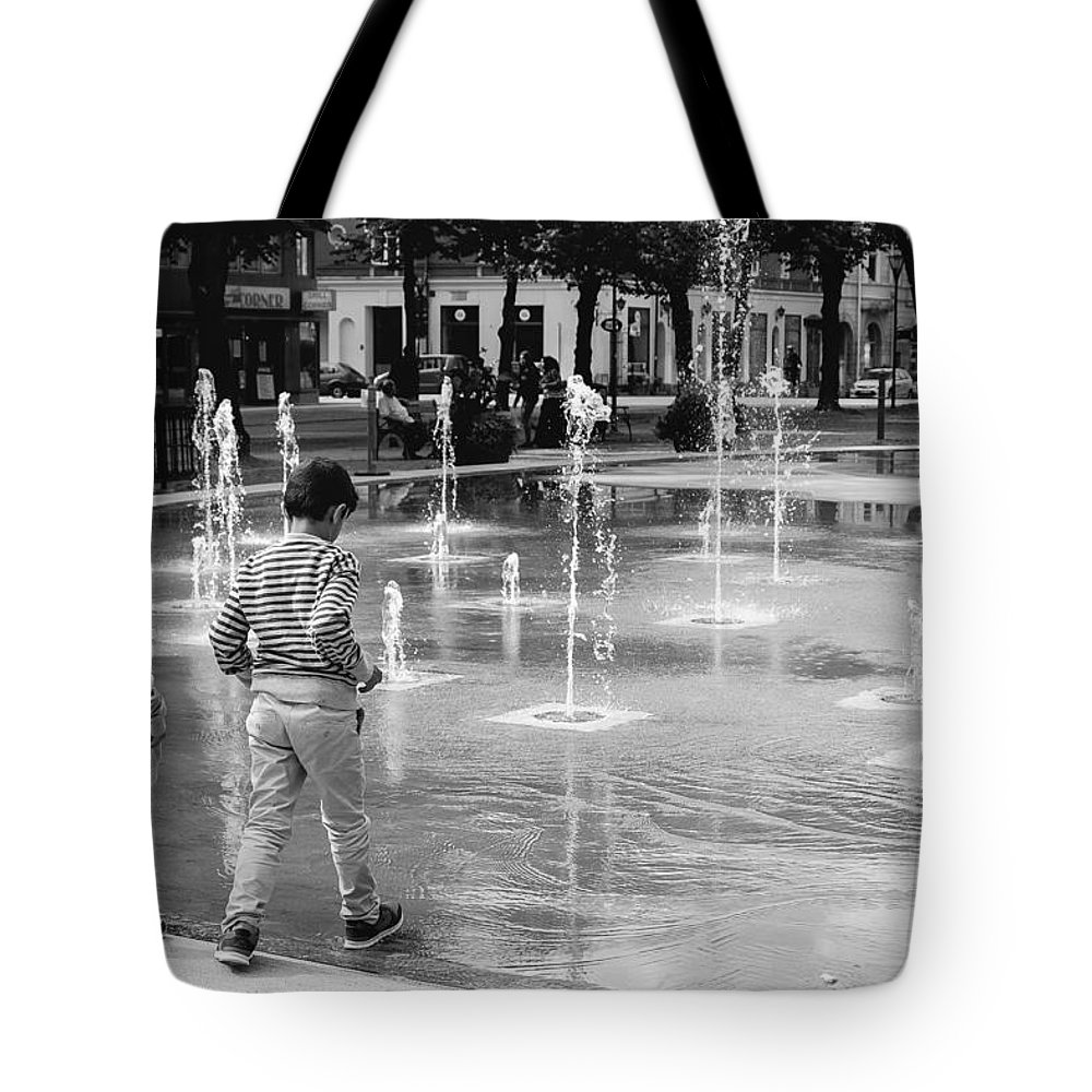 Children Tote Bag featuring the photograph Children Play By Fountain by Jimmy Karlsson