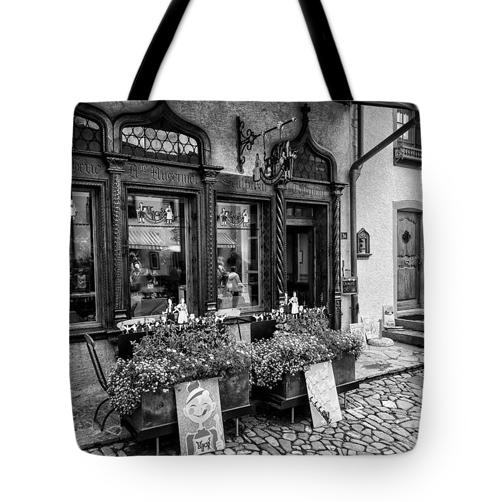 Leysin Tote Bag featuring the photograph Chocolatier In Gruyeres Bw by Timothy Hacker
