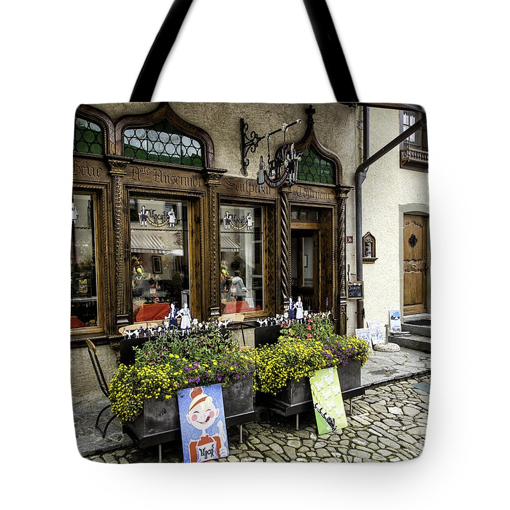 Leysin Tote Bag featuring the photograph Chocolatier In Gruyeres by Timothy Hacker