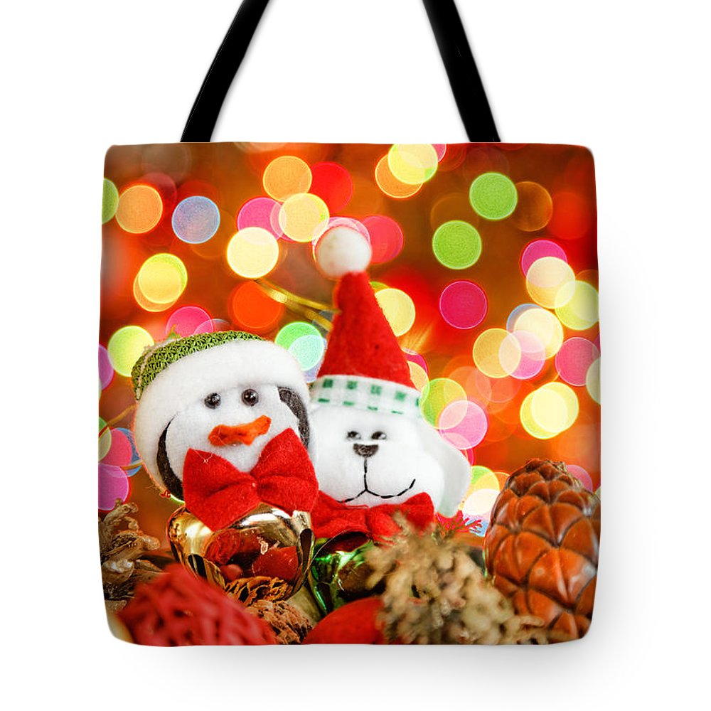 Background Tote Bag featuring the photograph Christmas Penguin And Puppy by Peter Lakomy