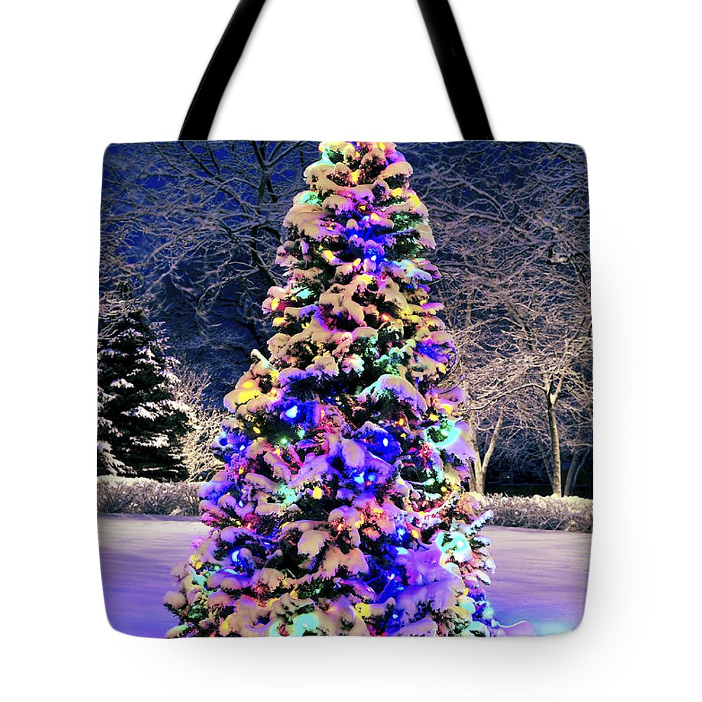 Christmas Tote Bag featuring the photograph Christmas tree in snow by Elena Elisseeva