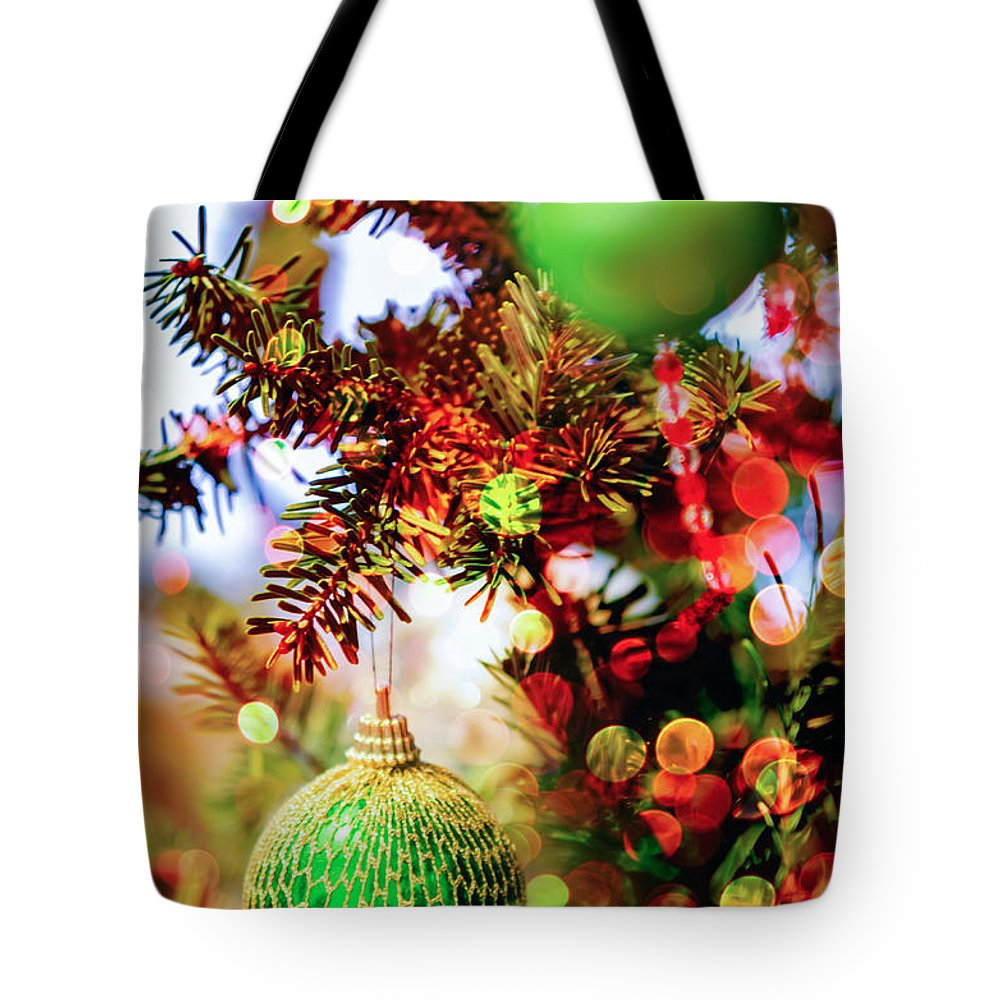 And Tote Bag featuring the photograph Christmas Tree Ornaments And Decorations by Alex Grichenko
