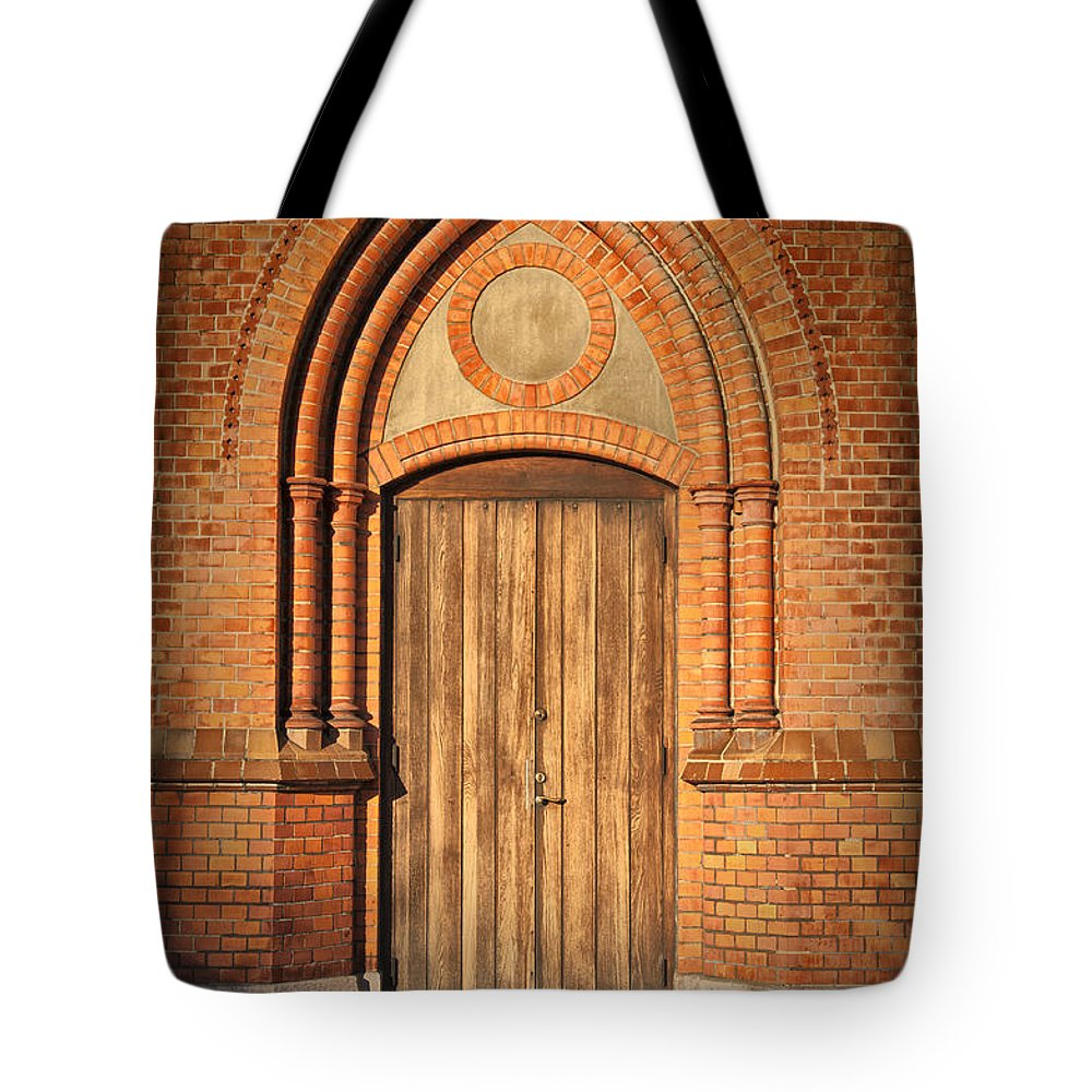 Entrance Tote Bag featuring the photograph Church Door Helsingborg by Antony McAulay