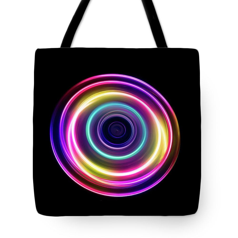 Focus Tote Bag featuring the photograph Circle Light Trails by Miragec