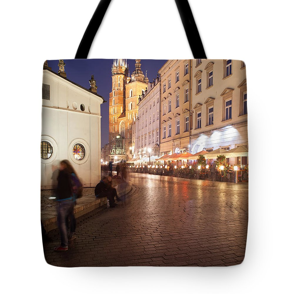 Krakow Tote Bag featuring the photograph City Of Krakow By Night In Poland by Artur Bogacki