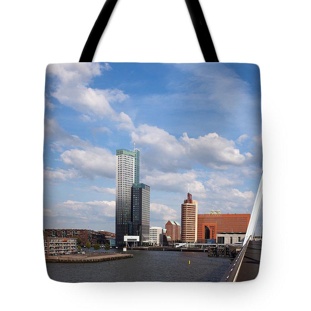 Rotterdam Tote Bag featuring the photograph City Of Rotterdam From Erasmus Bridge by Artur Bogacki