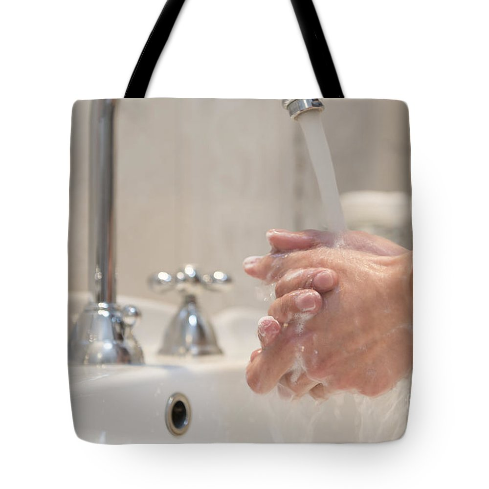 Sink Tote Bag featuring the photograph Cleaning Her Hands by Mats Silvan