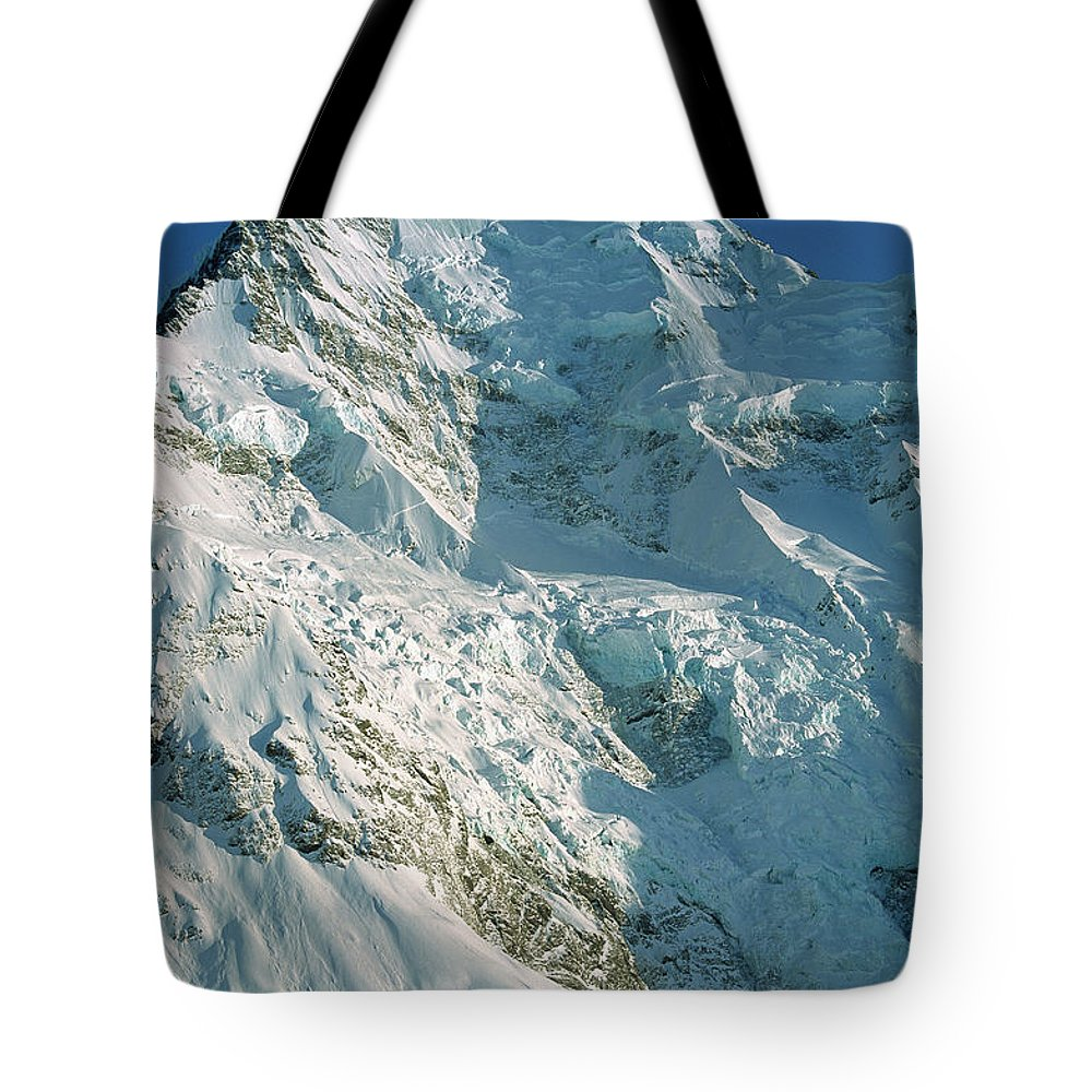 Ball Pass Tote Bag featuring the photograph Climber Enjoying View Of Mt Cook by Colin Monteath