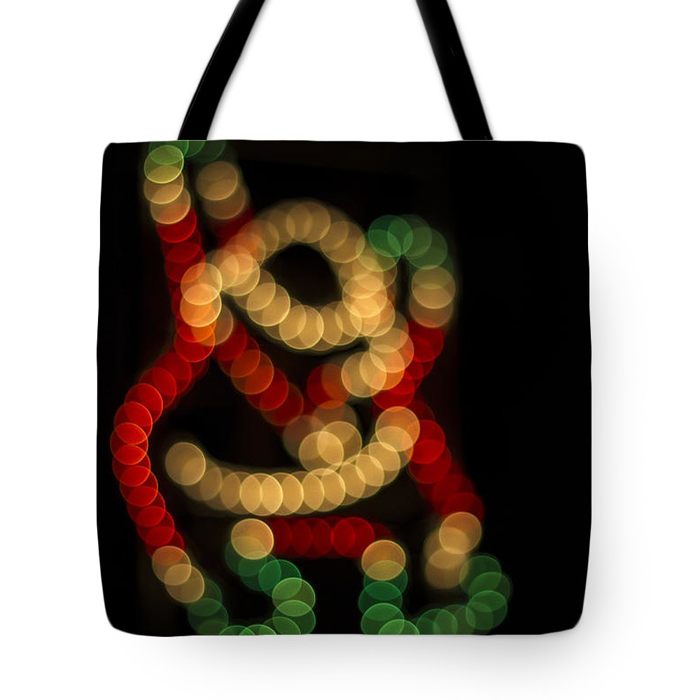 Clare Bambers Tote Bag featuring the photograph Climbing Santa by Clare Bambers