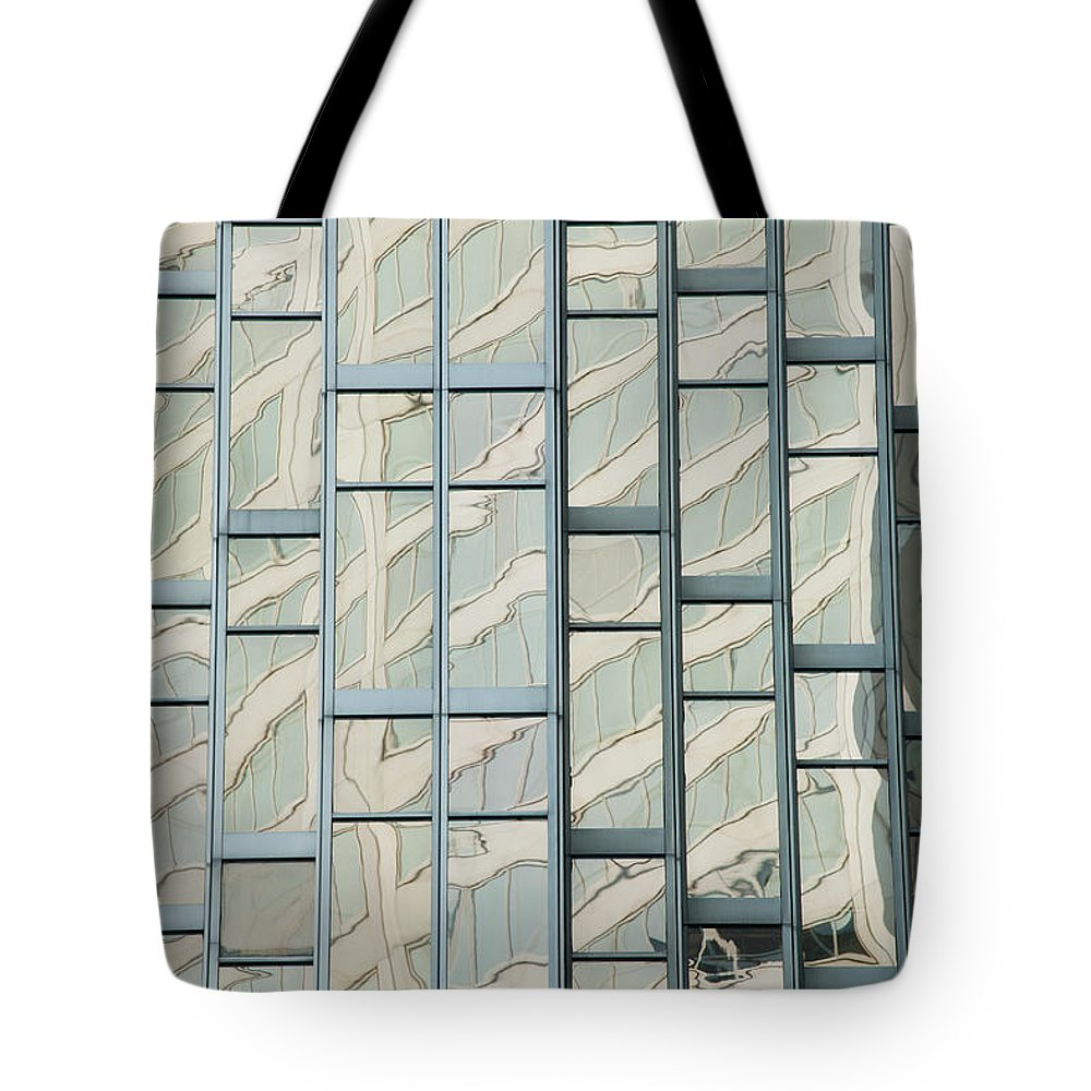 Rectangle Tote Bag featuring the photograph Close Up Of A Gold Glass Building by Michael Interisano / Design Pics