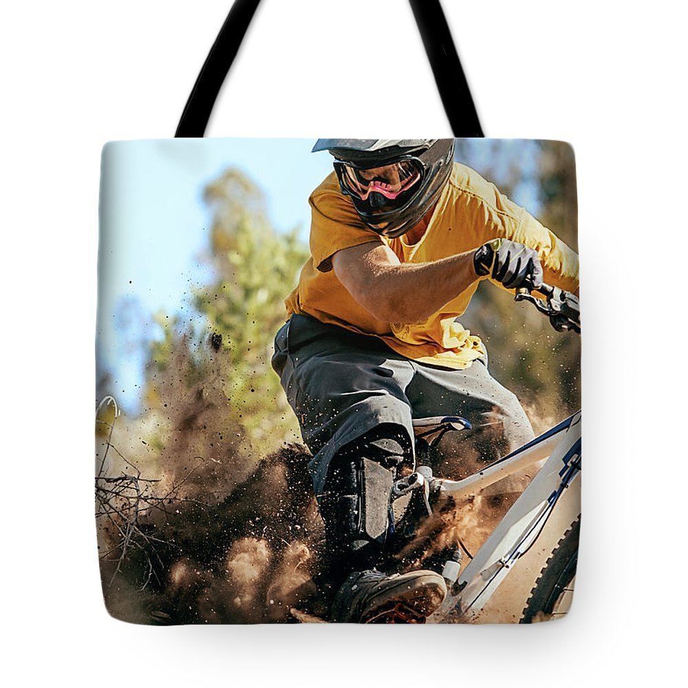 Headwear Tote Bag featuring the photograph Close Up Of A Mountain Biker Ripping by Daniel Milchev