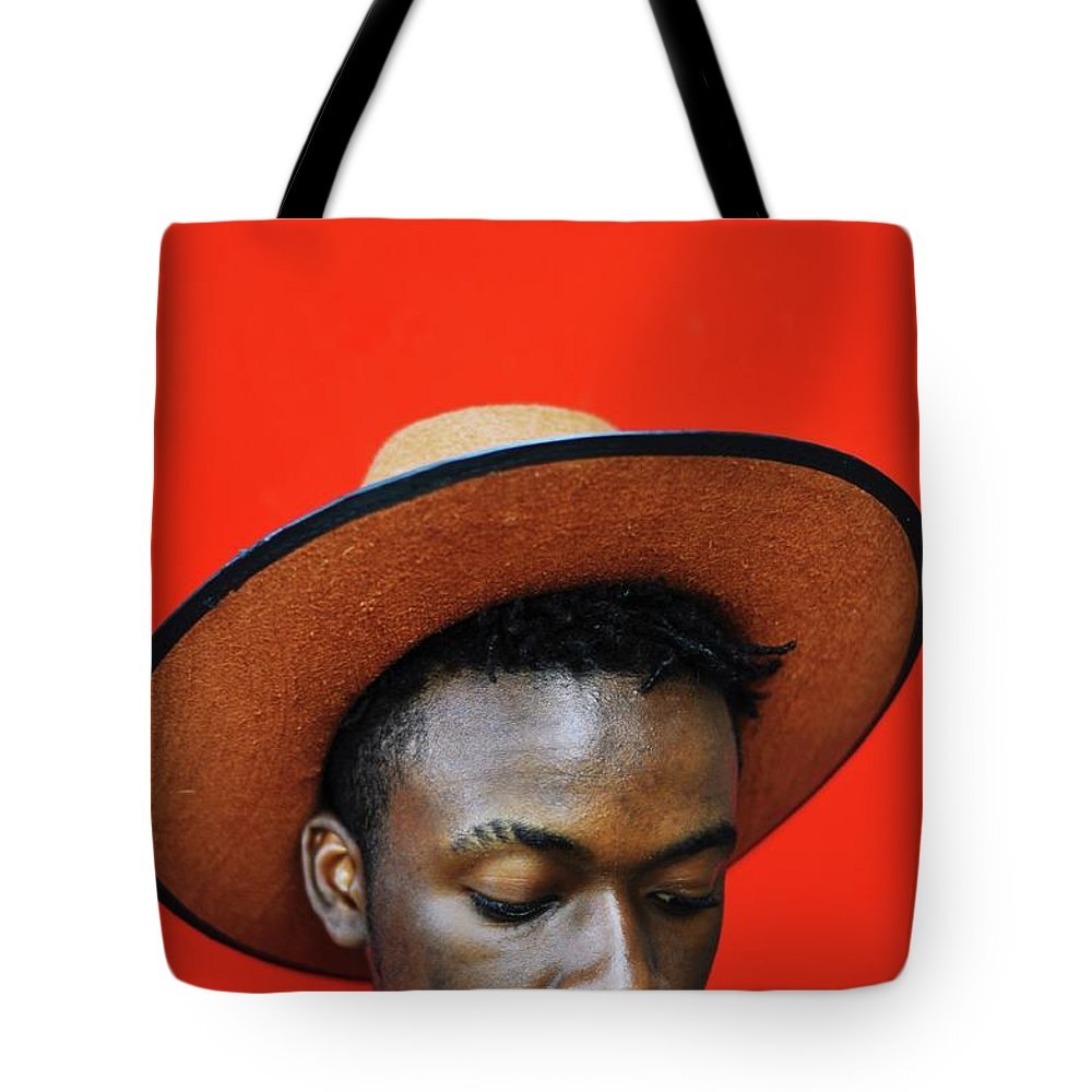 Young Men Tote Bag featuring the photograph Close-up Of Man Wearing Hat Against Red by Samson Wamalwa / Eyeem