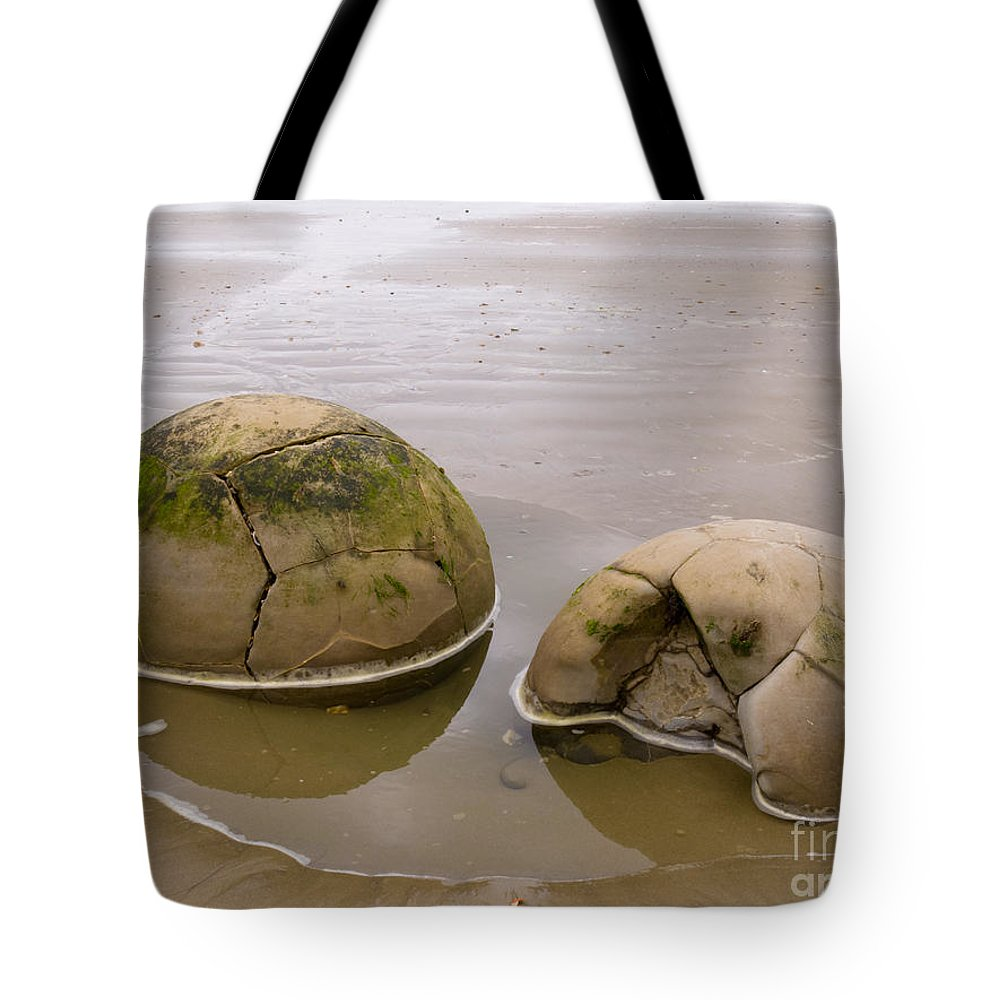 South Island Tote Bag featuring the photograph Closeup Of Famous Spherical Moeraki Boulders In Nz by Stephan Pietzko