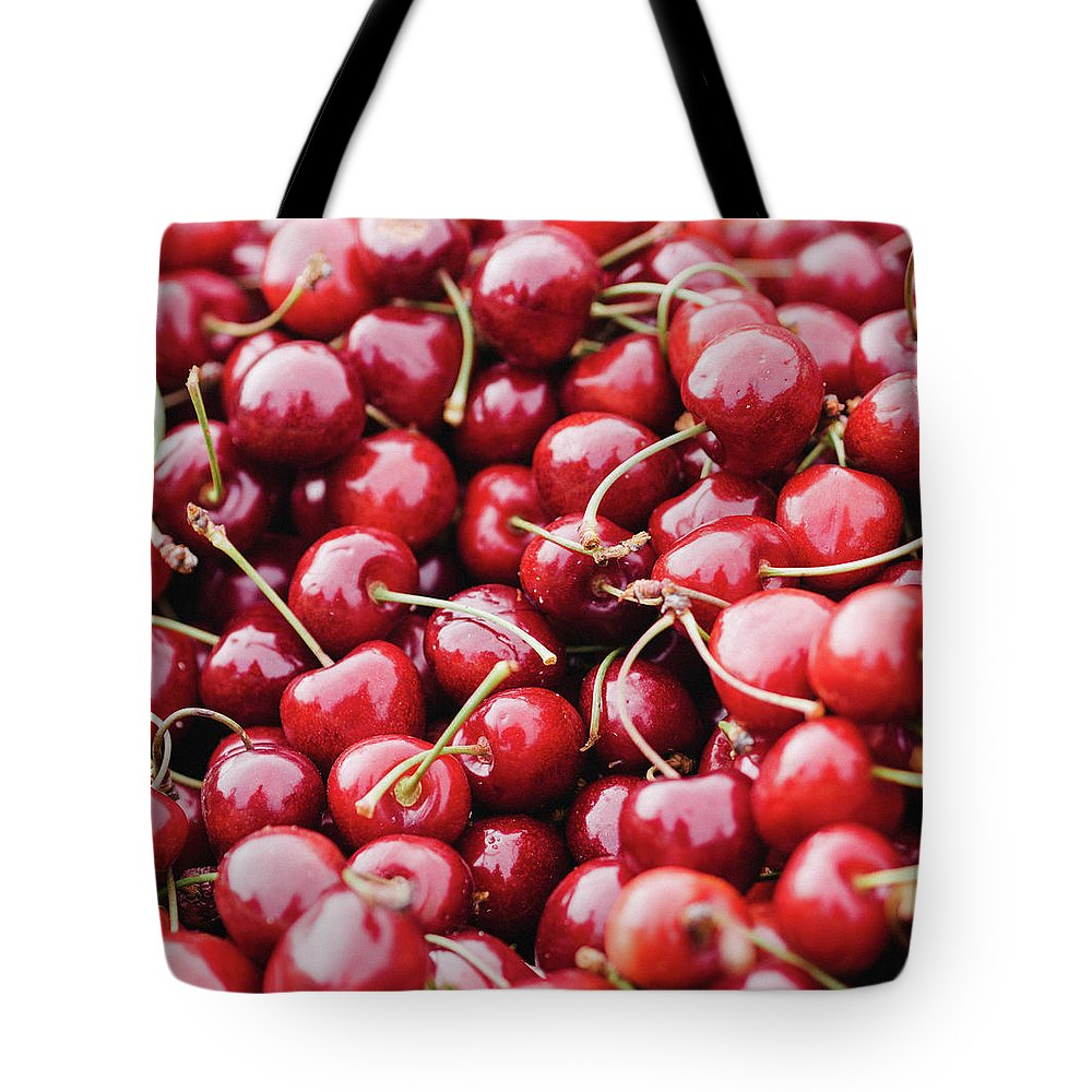 Cherry Tote Bag featuring the photograph Closeup Of Fresh Cherries by Miemo Penttinen - Miemo.net