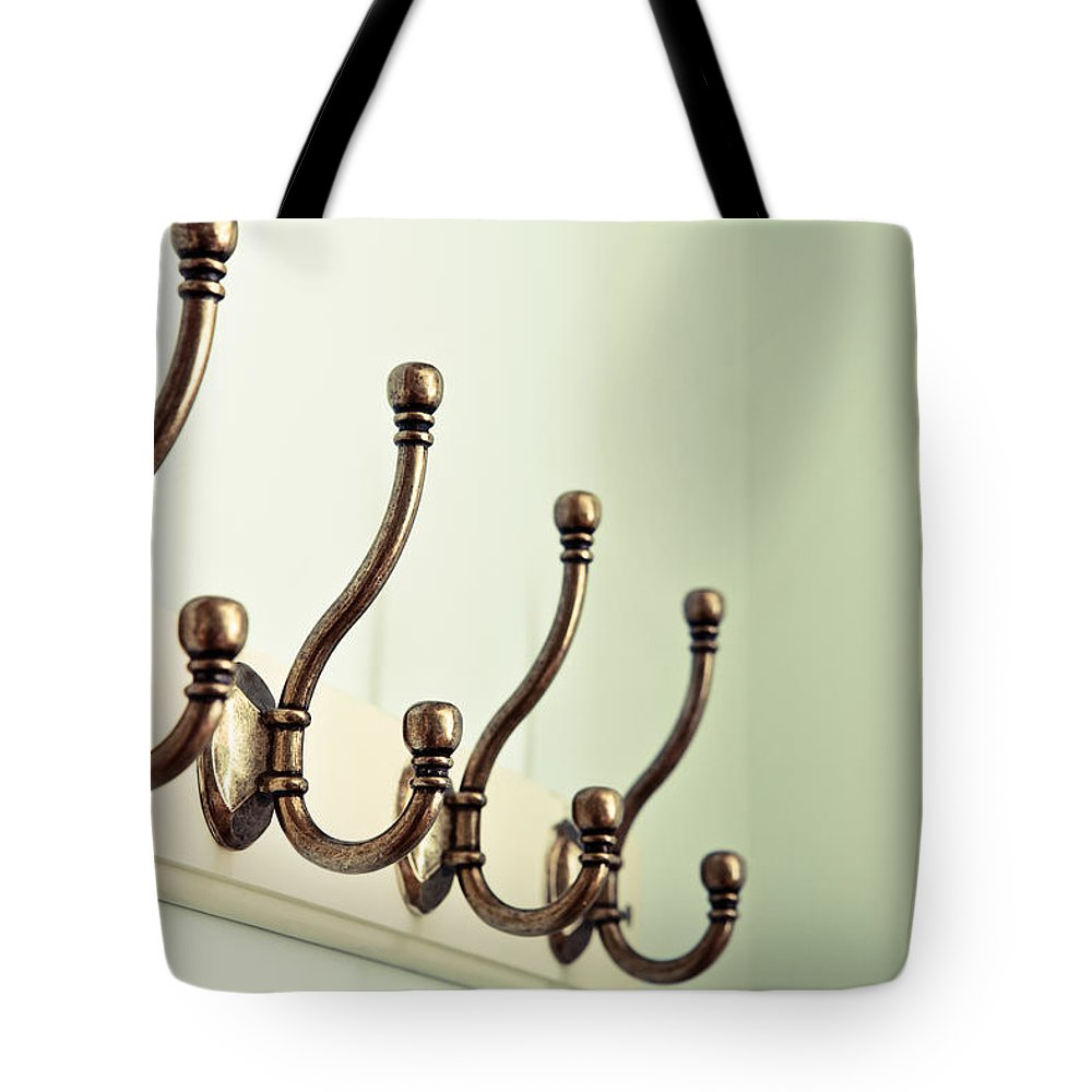 Accessory Tote Bag featuring the photograph Coat Hooks by Tom Gowanlock