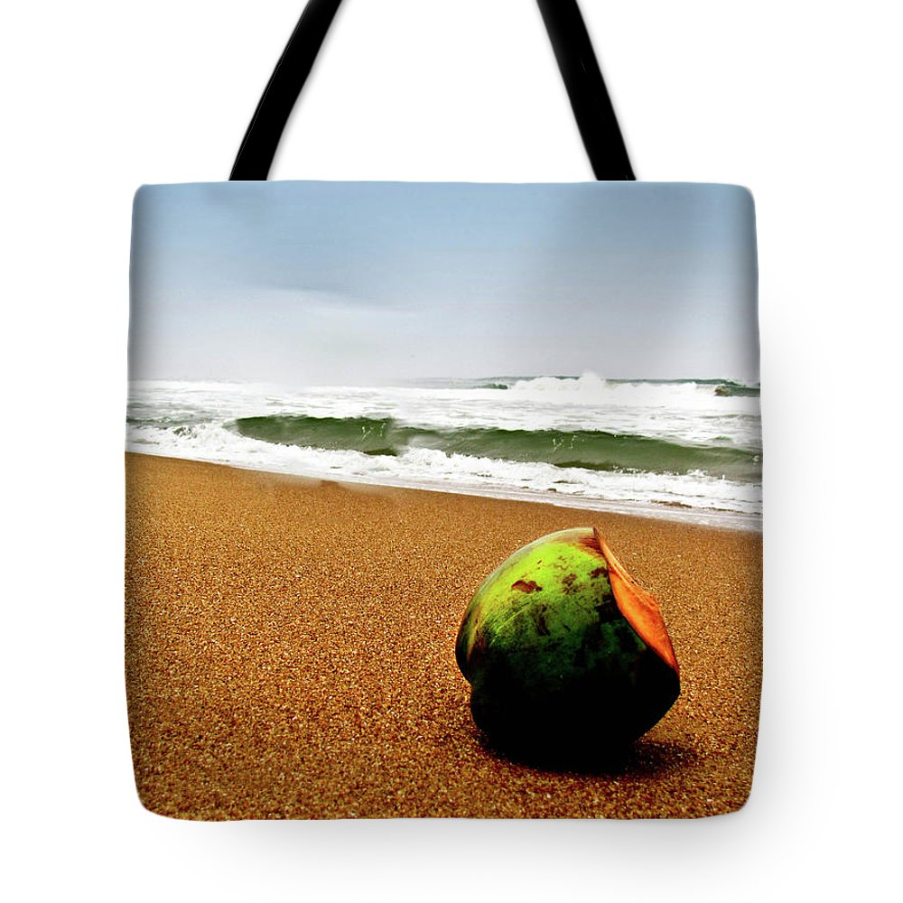 Tranquility Tote Bag featuring the photograph Coconut On Sandy Beach With Waves And by Amlan Mathur