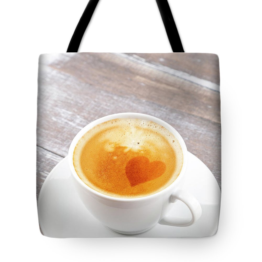 Cappuccino Tote Bag featuring the photograph Coffee by Focusstock