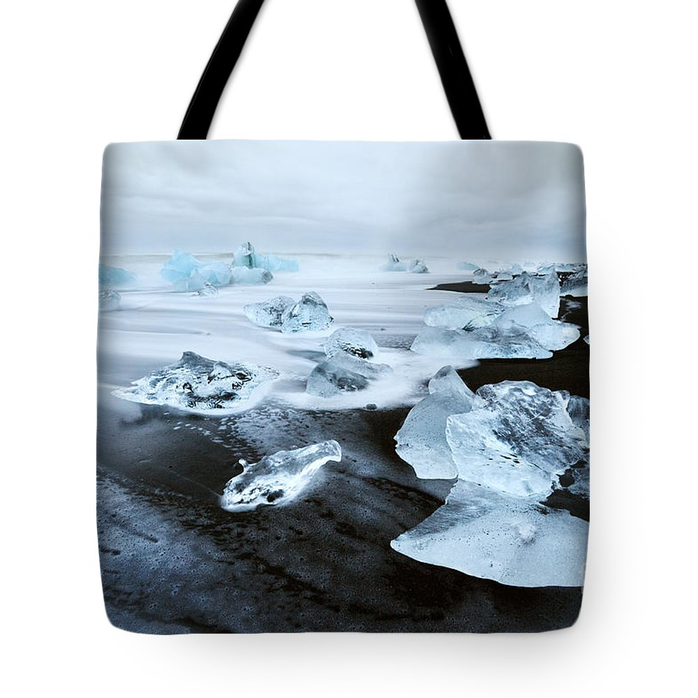 Ice Tote Bag featuring the photograph Cold Diamonds by Matteo Colombo