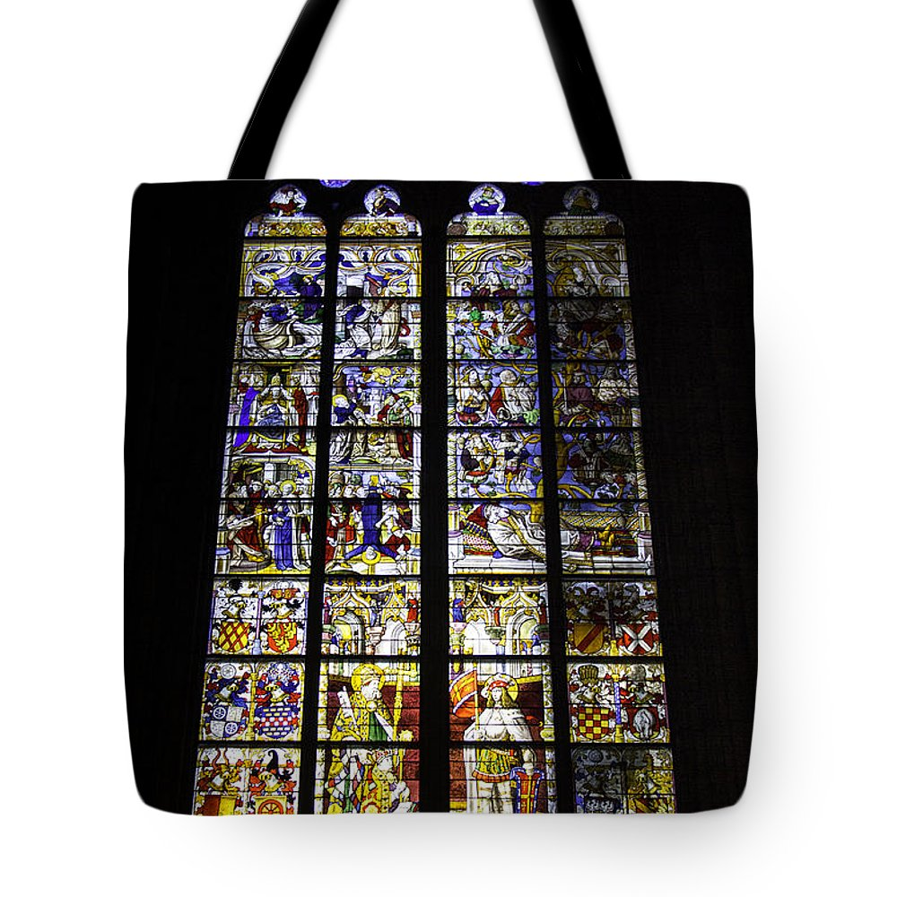 Cologne Cathedral Tote Bag featuring the photograph Cologne Cathedral Stained Glass Window Of St Peter And Tree Of Jesse by Teresa Mucha
