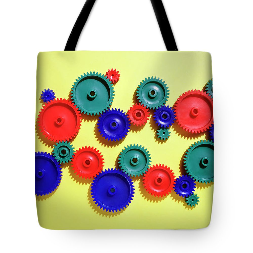 Working Tote Bag featuring the photograph Colored Gears by Joseph Clark