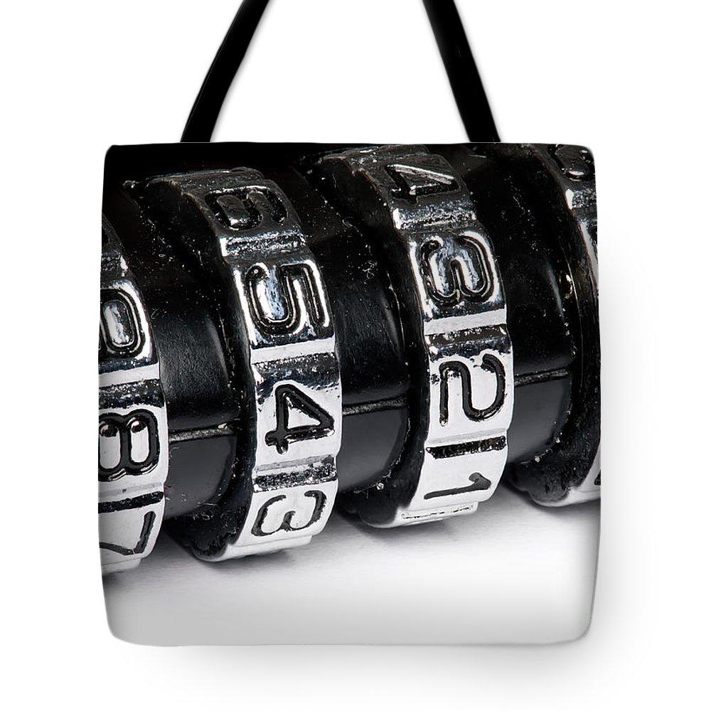 Padlock Tote Bag featuring the photograph Combination Lock Macro by Simon Bratt Photography LRPS