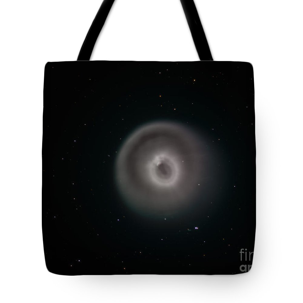Black Tote Bag featuring the photograph Comet 17pholmes After The Comet Erupted by Reinhold Wittich